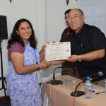A participant receiving the certificate of participation